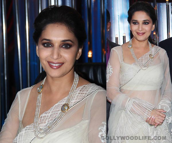 Why is Madhuri Dixit wearing coloured lenses?