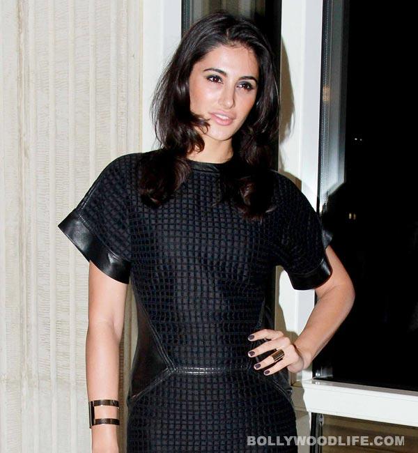 Why does Nargis Fakhri prefer hunkalicious John Abraham to lean Ranbir Kapoor?