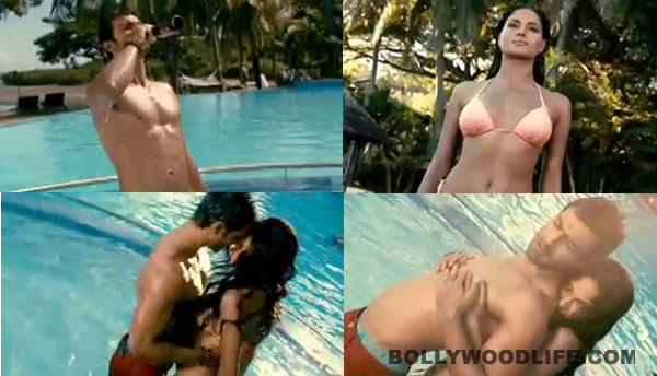What is Veena Malik doing with Ashmit Patel in a swimming pool?