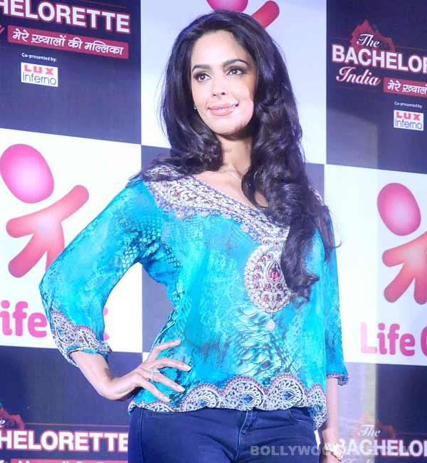 Mallika Sherawat kisses a suitor on The Bachelorette India!