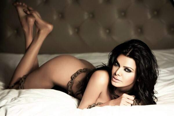Why is Sherlyn Chopra chained naked in a bed?