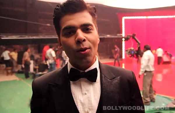 What does Karan Johar gossip about behind the stars' backs?-Watch video!