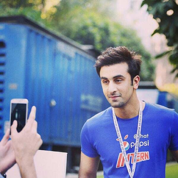 What is Ranbir Kapoor doing at the IPL 7 auction? View pics!