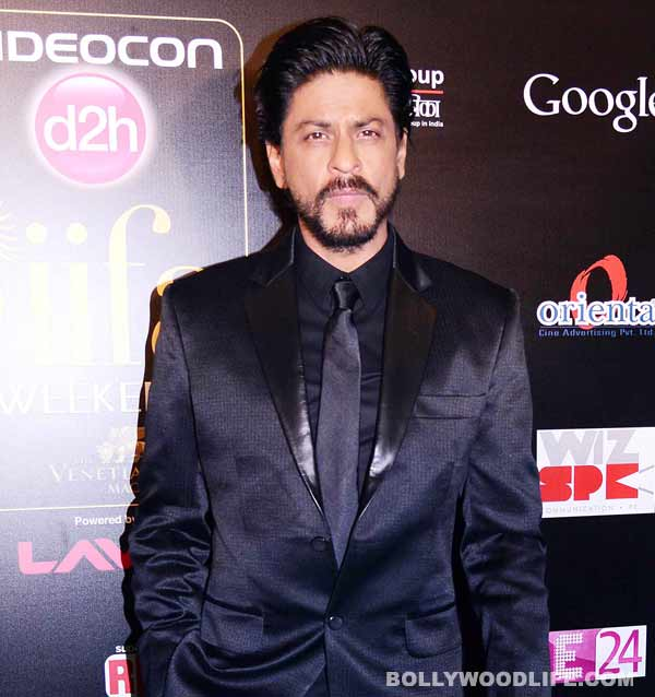 Who visited Shahrukh Khan on the sets of Happy New Year?