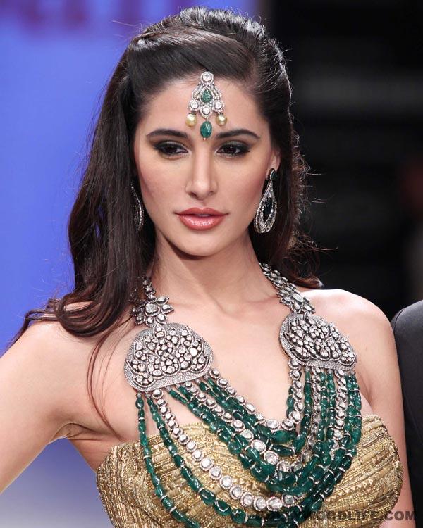 Why is Nargis Fakhri proud of herself?