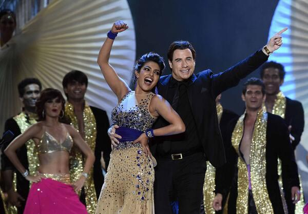 IIFA 2014: John Travolta grooves to Bollywood music with Priyanka Chopra - View pics!