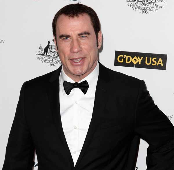 What is John Travolta doing at the 15th IIFA awards?