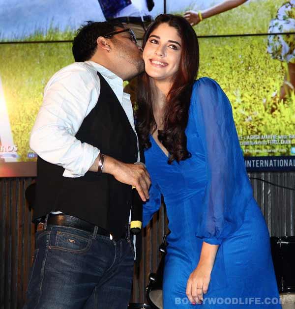 Mika Singh can't keep his hands of Virat Kohli's ex girlfriend – View pics!