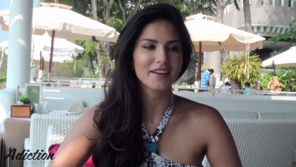 What is sexy Sunny Leone's addiction on the beach? Watch video!
