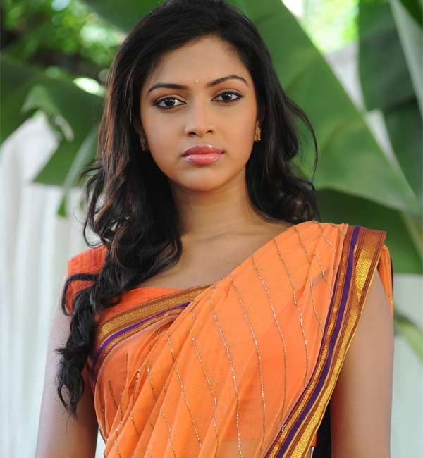 Who is designing Amala Paul's wedding outfits?