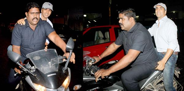 Spotted: Akshay Kumar riding pillion on his bodyguard's bike-View pics!