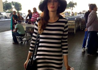Evelyn Sharma clean bowls airport style in a monochrome look –view pic!