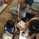 Sweet! Shah Rukh Khan's kids Aryan, Suhana, AbRam caught in one frame, seriously engrossed in colouring activity! - view pic