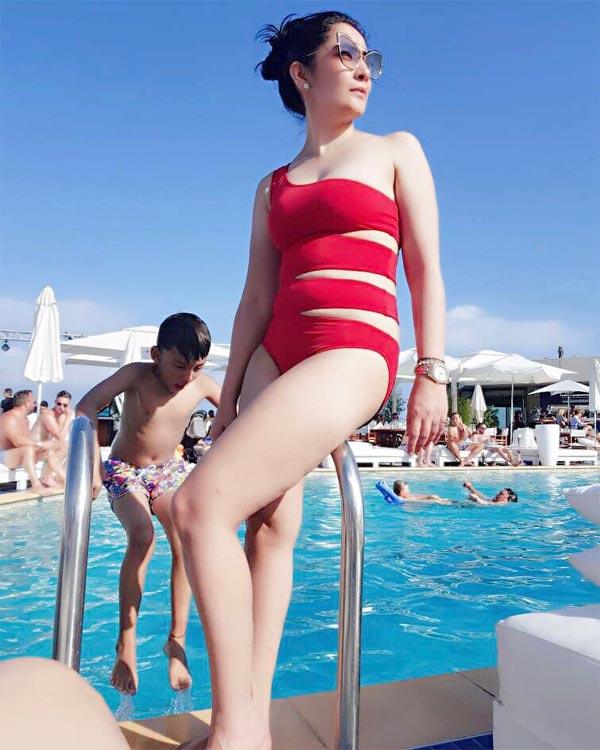 Image result for manyata dutt in red swimsuit pics