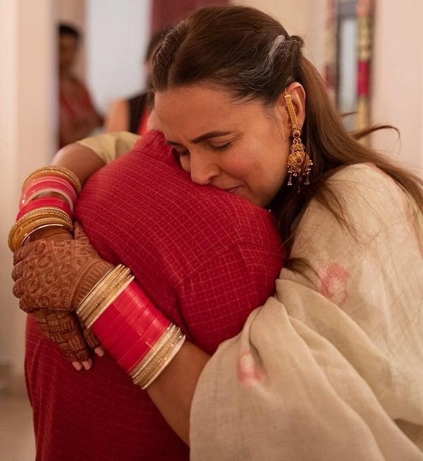 [View pic] An emotional Neha Dhupia hugs her dad tight during the bidaai ceremony