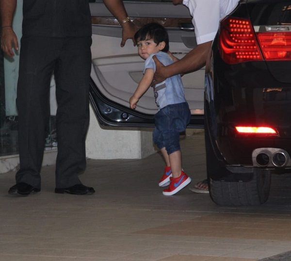 It's playtime for Taimur Ali Khan, but he just won't stop looking at the paparazzi - view pics and video